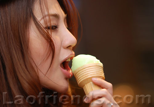 Lao girl eating an ice-cream cone