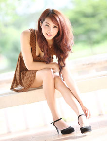 Sexy Lao girl wearing a black on brown dotted mini dress